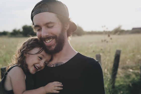 caroline-hernandez-177784-unsplash+man+caring+daughter+in+a+field+happy+smiles