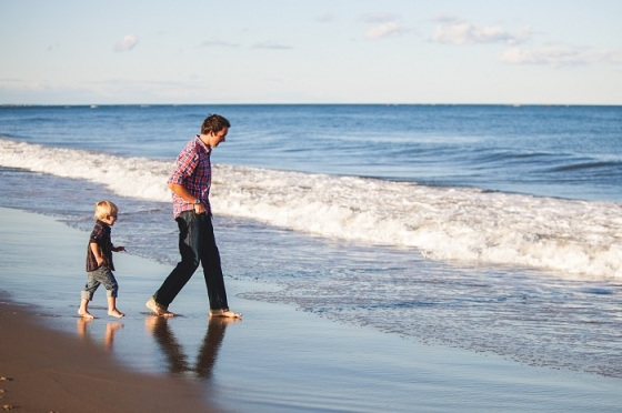 danielle-macinnes-88493-unsplash+father+son+at+beach+sand+water