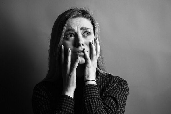 Portrait of scared young woman. Black and white.jpg